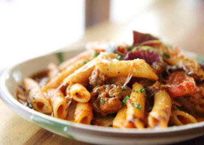 Penne pasta in tomato sauce with meatballs